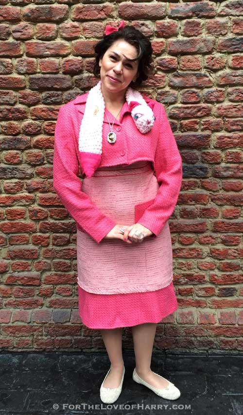 A woman dressed up as Dolores Umbridge