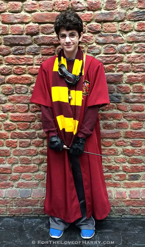 A boy dressed up in a Harry Potter Quidditch costume