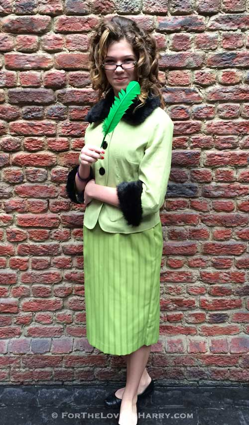 A woman dressed up in a Rita Skeeter costume