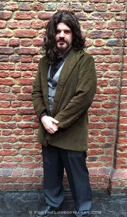 A man dressed up in a Sirius Black costume