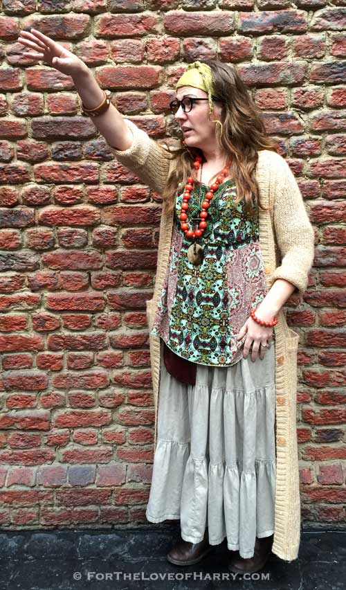 A woman dressed up in a Sybill Trelawney costume
