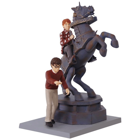 This is the front of the 2017 Harry Potter ornament of Ron Weasley and Harry playing wizard chess from the 1st film.